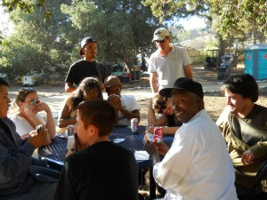 Community members playing uno during a rehearsal break, 2010.